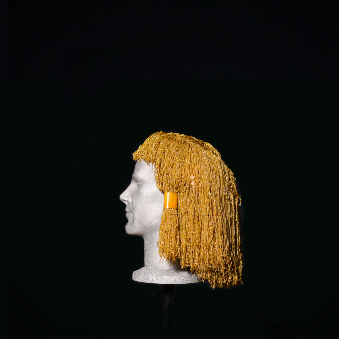 Parrucca in tripolina color oro
